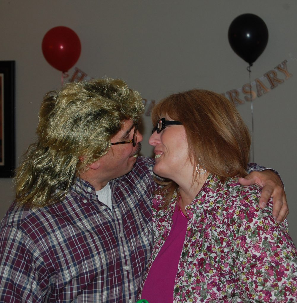 Josh and Sherry clowing around at their anniversary